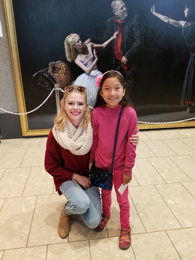 Alexandra Annas posing with an aspiring ballerina during ArtPrize in Grand Rapids