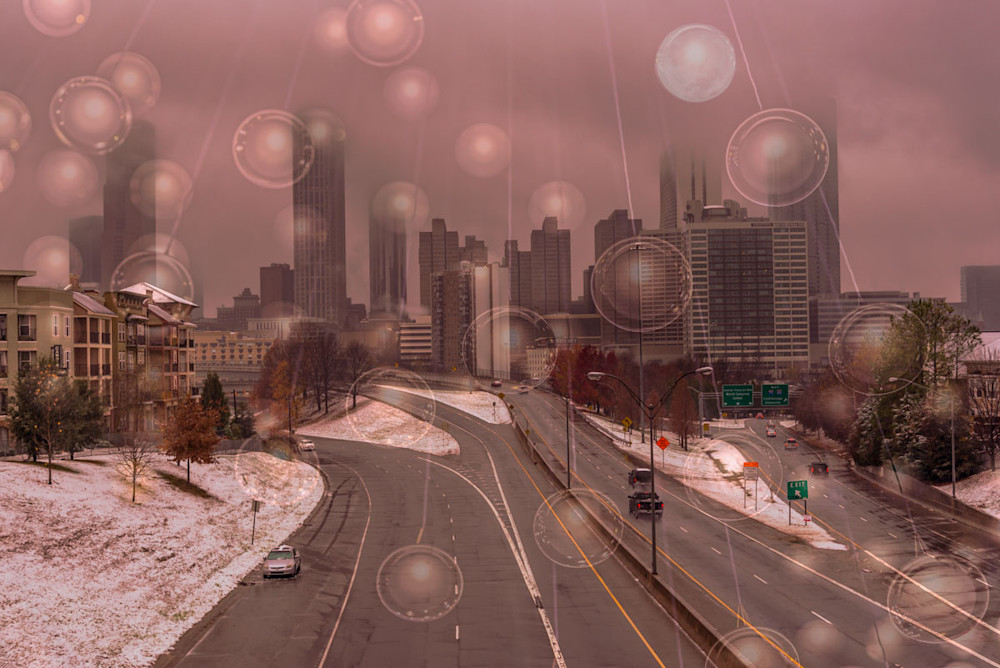 A composite photo of bubbles on a thread over the Jackson St. Bridge in Atlanta