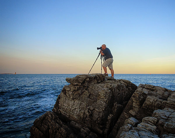 Rick Berk photographing on the Maine coast.
