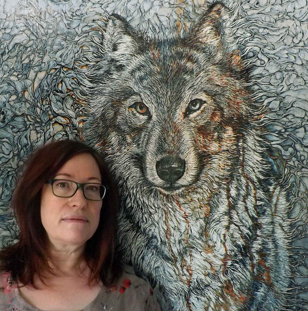 Col Mitchell poses with art of wolf