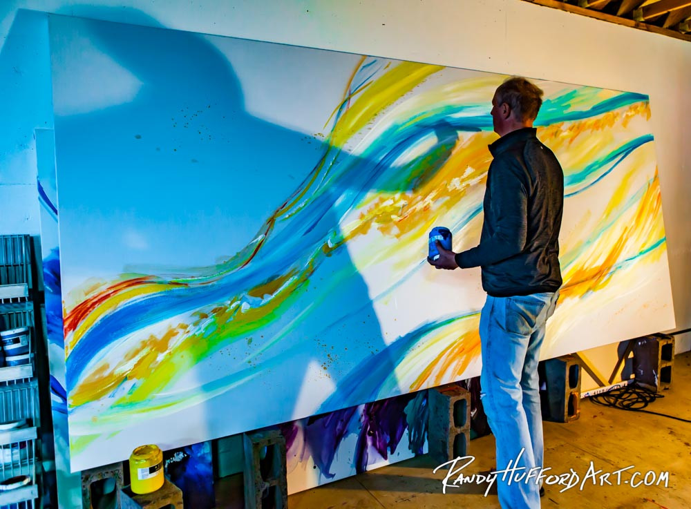 Artist Spar Street painting on a canvas we stretched for Him!