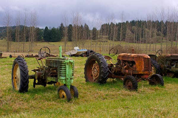 tractors and a boat in a green field