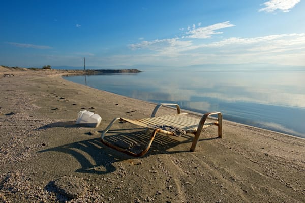 an abandoned lounge chair in the early morning light, salton sea, ca