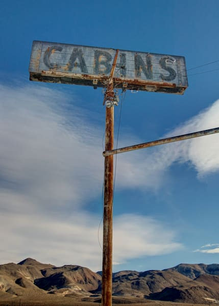 an old sign in the desert for cabins on hwy 395 in about 2004.