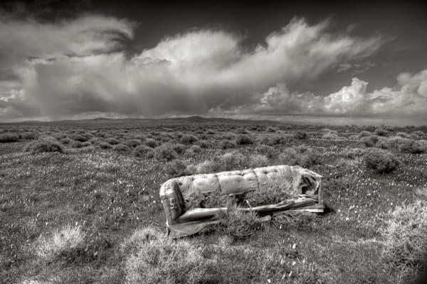 photo of an abandoned couch in the california high desert