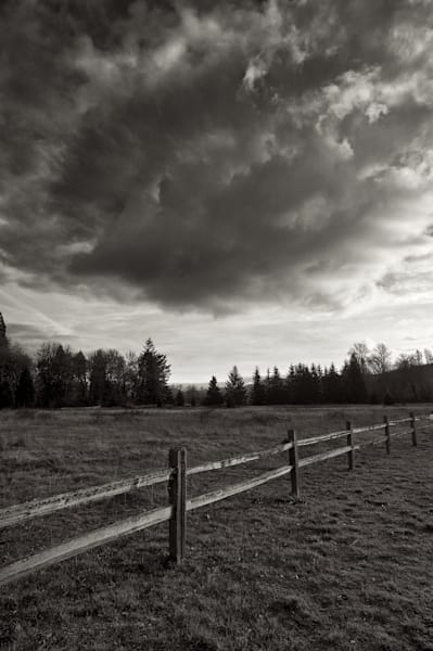 image of a fence and big clouds at elijah bristow state park just outside of eugene, oregon