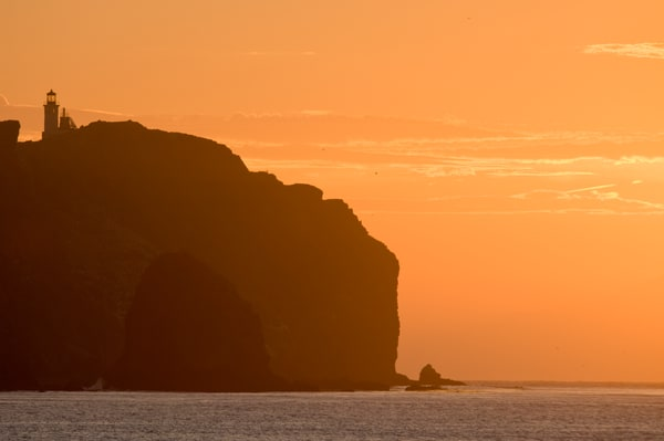Anacapa Island, Channel Islands National Park and National Marine Sanctuary, California; sunrise over the east end of East Anacapa Island and the lighthouse