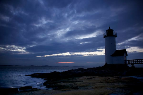 annisquam lighthouse beach sunset dark clouds seascape gloucester