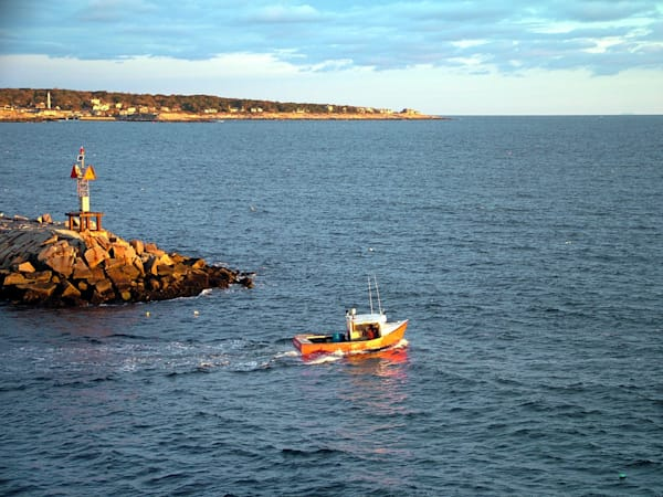 lobsterboat leaving rockport harbor sunrise
