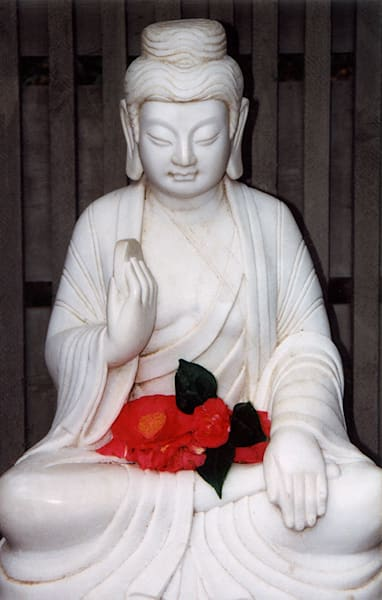 Buddha With Red Flowers