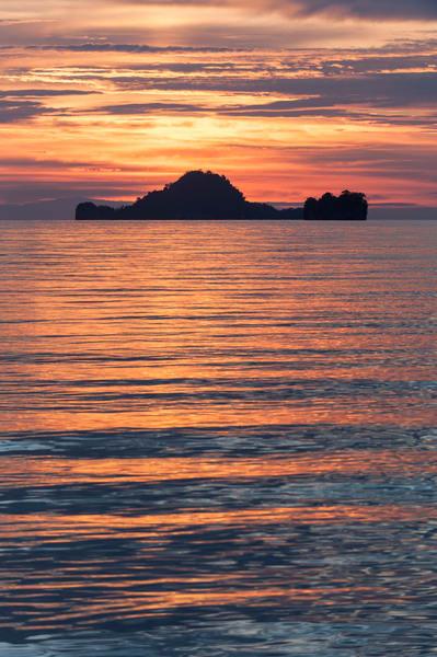 Sunset Rock Island Silhouette, Triton Bay, Indonesia
