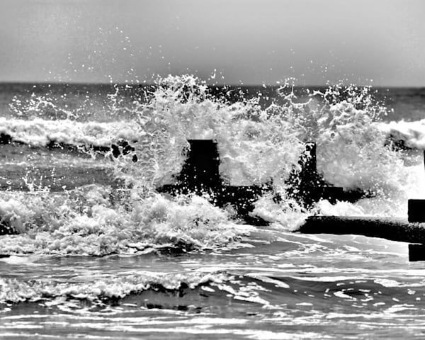 Wave at the Jetty by John Feiser is a photographer.