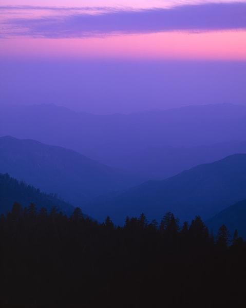Receding ridges of blue and purple