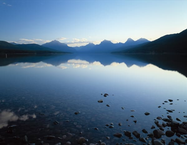 Fine art print of rugged mountains reflecting into Lake McDonald in Glacier National Park, Montana