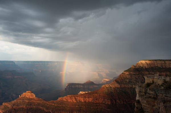 Monsoon storm and rainbow over the Grand Canyon from Mather Point, Grand Canyon National Park, Arizona