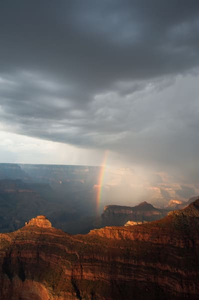 Monsoon storm and rainbow