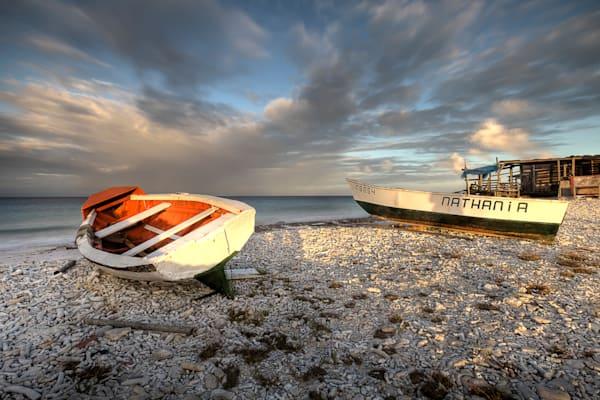 Photograph of wooden boats along coast