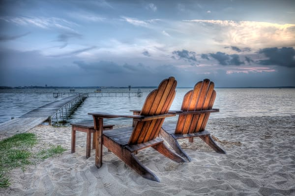 Photograph of beach chairs at dusk