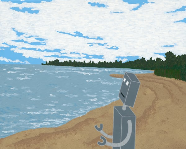 A robot stands on a beach looking at the water.
