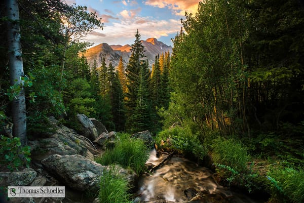 The beautiful Morning Glow is captured over Long's peak RMNP
