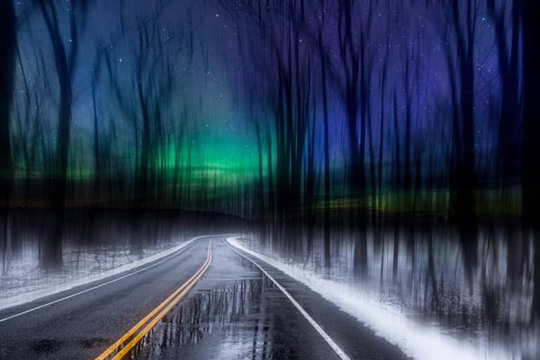 Aurora Road. Surreal fine art creation. Dreamscape of midnight forest amidst brilliant Aurora-colored skies by fine art photographer Mike Taylor of Taylor Photography.