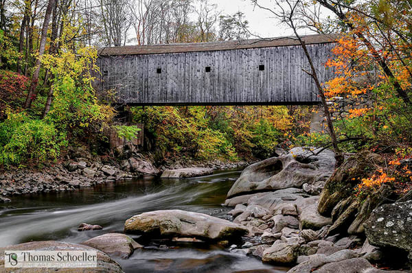 The iconic covered bridge of South Kent Connecticut during fall foliage