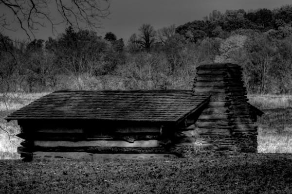 A Black and White Fine Art Photograph of a Valley Forge Military Hut by Michael Pucciarelli