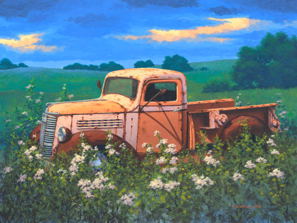 Old pick up truck in grass field