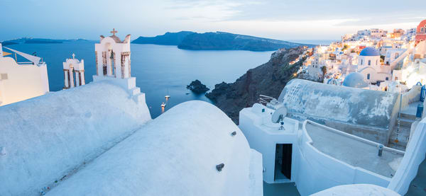 Evening in Oia, Santorini, Greece Panoramic Photo Print by Brad Scott