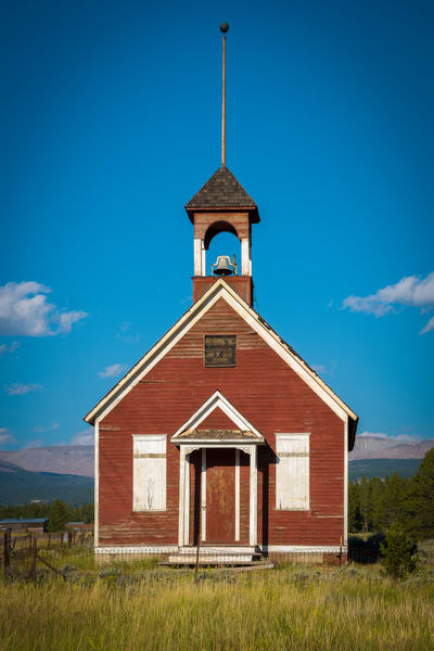 Vertical Photo of Old Red School House Leadville Colorado