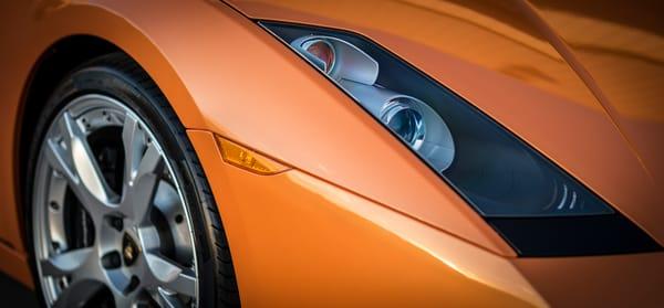 Close up photograph of Orange Lamborghini Gallardo's Headlights
