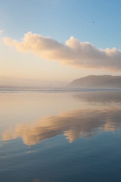 Reflections of color on the beach at Cannon Beach, Oregon
