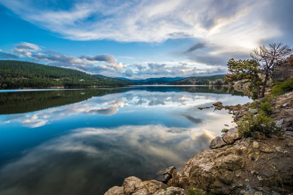 Horizontal Photograph of Boulder Colorado Reservoir Clouds Reflecting on Lake
