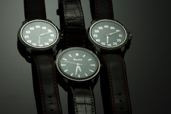 Fine Art Photographs of Three Watches on Black Plexiglass by Michael Pucciarelli