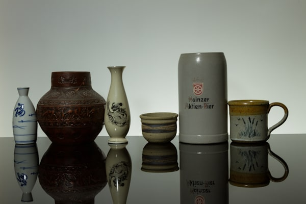 A Fine Art Photograph of Cups, Vases, Mugs Reflections on Black Plexi by Michael Pucciarelli