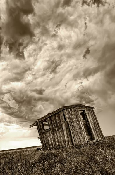A lonely abandoned shack in Roche Percee, Saskatchewan, Canada faces a brutal summer storm.