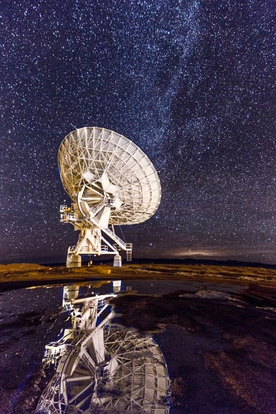 Reflection of the Very Large Array (VLA) at Night photograph for sale as art.