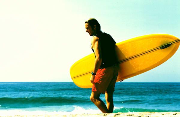 surfer, devon howard with tyler surfboard, singlefin yellow