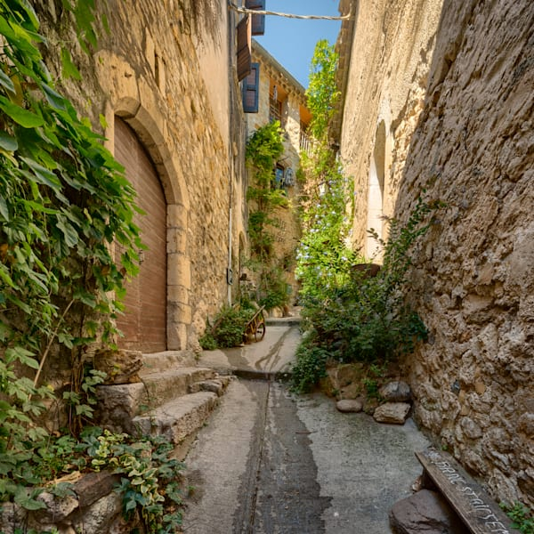 No room for an #SUV, barely enough room for a #wheelbarrow! This walkway off the main street of #SaintGuilhemleDesert in the #Languedoc region of #France is so inviting. Next time, I'll explore the #hotel!