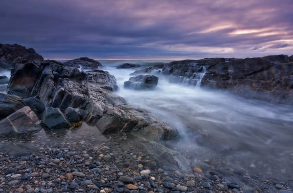 Purple sunset and incoming tide over Rye, NH waves