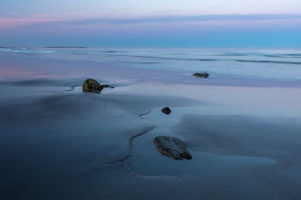 A soft pastel sunset on a stunning New Hampshire beach