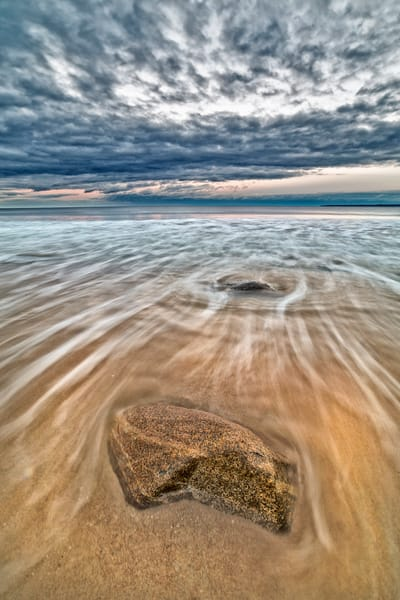 Long exposure of waves, rock and sky at Plum Island