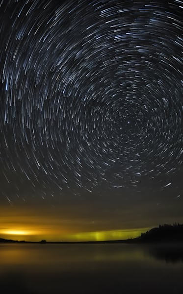Moosehead Lake comes alive with glowing startrails.