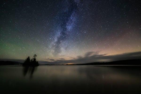 Moosehead Lake glowing beneath the Northern Lights.
