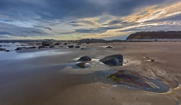 Dramatic sea boulders and sunset at Sandy Point