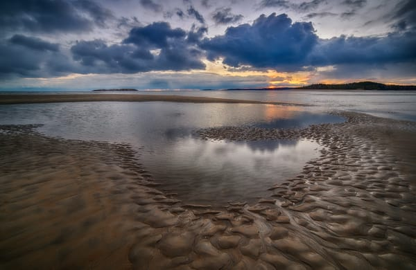 A heart-shaped puddle at Popham Beach at Sunset