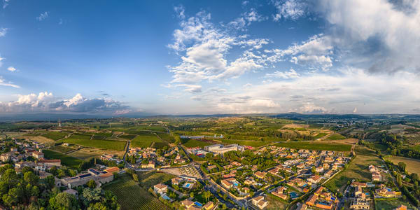 "A view over the #village of #Puilacher in the #Languedoc region of #France. The main buildings in the center are the wine cooperative ""Clochers et Terroirs""."