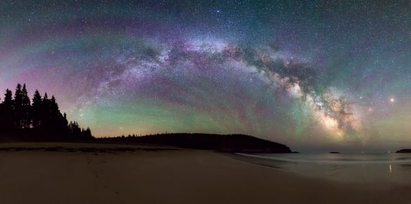 Panorama of Milky Way and Air Glow over Sand Beach in Acadia National Park, Maine