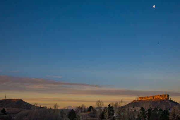 Photo of Moon and Hawk Over Castle Rock Colorado at Sunrise