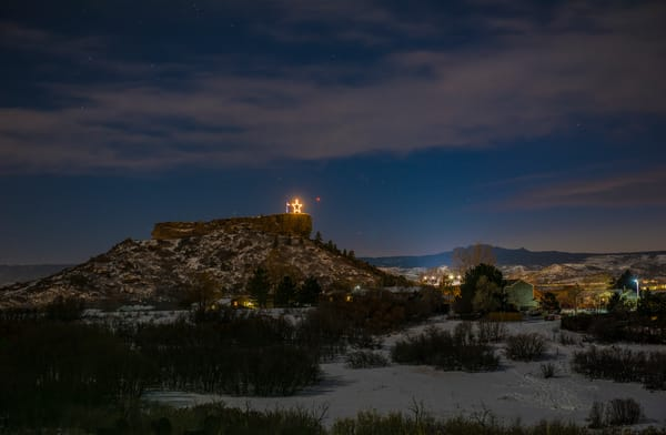 Night Photo of Star & US Flag on the Rock in Castle Rock Colorado